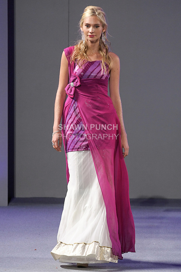 Model walks runway in an outfit from the WOW (Women Of the World) collection by Juhi Jagiasi, during Couture Fashion Week Spring 2013 in NYC, on September 16, 2012.