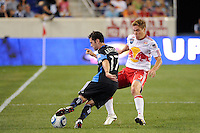 Joey Gjertsen (17) of the San Jose Earthquakes is defended by Chris Albright (3) of the New York Red Bulls. The New York Red Bulls defeated the San Jose Earthquakes 2-0 during a Major League Soccer (MLS) match at Red Bull Arena in Harrison, NJ, on August 28, 2010.