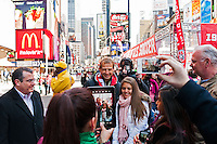 Fans pose for photographs with U.S. men's head coach Jurgen Klinsmann during the centennial celebration of U. S. Soccer at Times Square in New York, NY, on April 04, 2013.