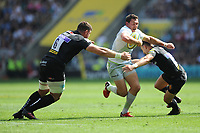 Alex Goode of Saracens is tackled by Dave Ewers and Sam Hill of Exeter Chiefs during the Aviva Premiership Rugby Final between Exeter Chiefs and Saracens at Twickenham Stadium on Saturday 26th May 2018 (Photo by Rob Munro/Stewart Communications)