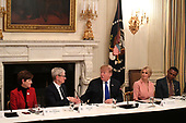 United States President Donald J. Trump (C) shakes hands with Apple CEO Tim Cook as board members (L-R) Iowa Governor Kim Reynolds (Republican of Iowa), First Daughter and Advisor to the President Ivanka Trump and Johnny C. Taylor, Jr of the Society for Human Resource Management watch at the American Workforce Policy Advisory Board meeting, at the White House, Washington, DC, March 6, 2019. The board consists of 25 members outside government, representing leading companies, academics and elected leaders.                <br /> Credit: Mike Theiler / CNP