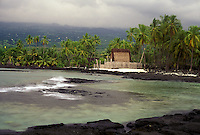 View showing Honaunau Bay, tidepools, and Hale O Keawe at Puu Honua O Honaunau National Historic Park (City of Refuge), in Kona, Hawaii.