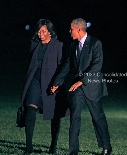 United States President Barack Obama and first lady Michelle Obama walk from Marine One on the South Lawn of the White House in Washington, DC to the Residence after a day of campaigning around the country for Hillary Clinton, the Democratic Party nominee for President on November 7, 2016.<br /> Credit: Dennis Brack / Pool via CNP