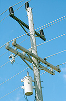 POWER LINES<br /> Closely cropped image of power lines &amp; transformer with clear afternoon sky.
