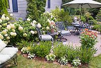 House, hydrangeas, garden bench, patio, great backyard landscaping