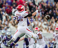 NWA Democrat-Gazette/JASON IVESTER <br /> Arkansas vs Kansas St, Liberty Bowl<br /> Kansas State cornerback Donnie Starks breaks up a pass intended for Arkansas wide receiver Drew Morgan (80) during the second quarter on Saturday, Jan. 2, 2016, at the Liberty Bowl in Memphis, Tenn.