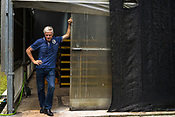 57 year old Frédéric Viala, president of Entofood, (the pilot project involving maggot production) poses in front of the greenhouse in village Kundang, at the outskirts of capital Kuala Lumpur, Malaysia.