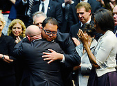 "Daniel Hernandez, Jr. (C), an intern of United States Representative Gabrielle Giffords (Democrat of Arizona), hugs her husband NASA astronaut Mark Kelly (L) as first lady Michelle Obama looks on during the event ""Together We Thrive: Tucson and America"" honoring the January 8 shooting victims at McKale Memorial Center on the University of Arizona campus on Wednesday, January 12, 2011 in Tucson, Arizona. The memorial service is in honor of victims of the mass shooting at a Safeway grocery store that killed six and injured at least 13 others, including U.S. Representative Gabrielle Giffords (Democrat of Arizona), who remains in critical condition after being shot in the head. Among those killed were U.S. District Judge John Roll, 63; Giffords' director of community outreach, Gabe Zimmerman, 30; and 9-year-old Christina Taylor Green. .Credit: Kevork Djansezian / Pool via CNP"