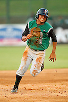 Ydwin Villegas #28 of the Augusta GreenJackets hustles towards third base against the Kannapolis Intimidators at Fieldcrest Cannon Stadium June 24, 2010, in Kannapolis, North Carolina.  Photo by Brian Westerholt / Four Seam Images
