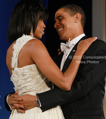 Washington, DC - January 20, 2009 -- United States President Barack Obama dances with First Lady Michelle Obama at the Eastern-States Inaugural Inuagural Ball at Union StationJanuary 20, 2009 in Washington, DC. Obama was sworn in as the 44th President of the United States, becoming the first African American to be elected President of the U.S. .Credit: Mark Wilson - Pool via CNP
