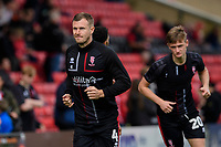 Lincoln City's Michael O'Connor, left, with team-mate Callum Connolly during the pre-match warm-up<br /> <br /> Photographer Chris Vaughan/CameraSport<br /> <br /> The EFL Sky Bet League One - Lincoln City v Sunderland - Saturday 5th October 2019 - Sincil Bank - Lincoln<br /> <br /> World Copyright © 2019 CameraSport. All rights reserved. 43 Linden Ave. Countesthorpe. Leicester. England. LE8 5PG - Tel: +44 (0) 116 277 4147 - admin@camerasport.com - www.camerasport.com