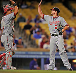 22 July 2011: Washington Nationals closing pitcher Drew Storen gets a high-five from catcher Wilson Ramos at the conclusion of play against the Los Angeles Dodgers at Dodger Stadium in Los Angeles, California. The Nationals defeated the Dodgers 7-2 in their first meeting of the 2011 season. Mandatory Credit: Ed Wolfstein Photo