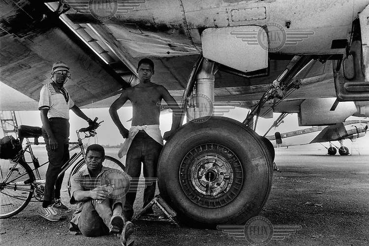 Maintenance staff in front of a DC-3 Dakota aircarft at Beira airport. Dakotas played an essential role in emergency operations during the civil war (1976-1992), distributing food and other essential items to displaced people.