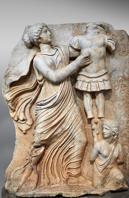Roman Sebasteion relief  sculpture of a Goddess inscribing a trophy, Aphrodisias Museum, Aphrodisias, Turkey.  Against an art background.<br /> <br /> A draped goddess strides forward to inscribe a military trophy to which is bound a kneeling female captive. The goddess is probably a personification such as Honour, Virtue or Courage.