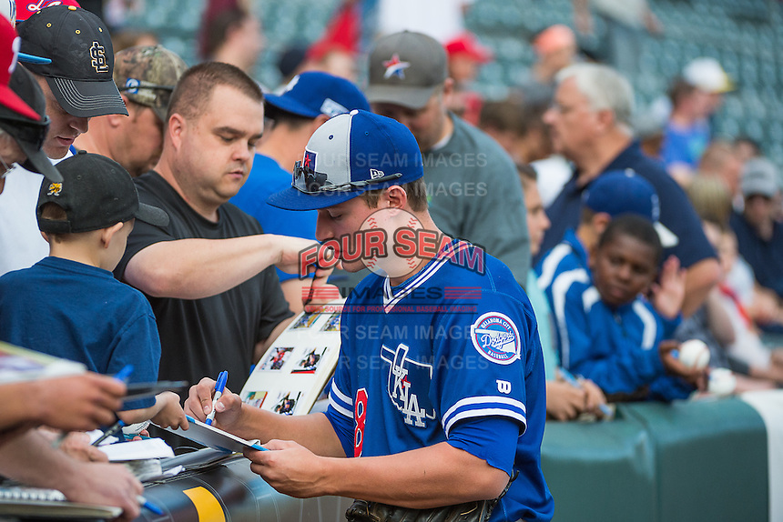 Corey Seager (18) of the Oklahoma City Dodgers signs autographs before the game against the Salt Lake Bees in Pacific Coast League action at Smith's Ballpark on May 25, 2015 in Salt Lake City, Utah. Seager was the first-round pick (18th overall) in the 2012 Draft for the Los Angeles Dodgers.  (Stephen Smith/Four Seam Images)