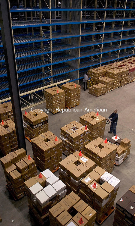 WATERTOWN, CT - 27 April 2004 - 042704TH08 -  Robert Berry of Waterbury, a 4-year employee of ArchivesOne, moves boxes at one of ArchivesOne warehouses with 40-foot ceilings located on Commercial Street in Watertown.  TODD HOUGAS PHOTO