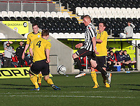 Jon Robertson takes Tyler Fulton on tracked by Kris Faulds in the St Mirren v Falkirk Clydesdale Bank Scottish Premier League Under 20 match played at St Mirren Park, Paisley on 30.4.13. .