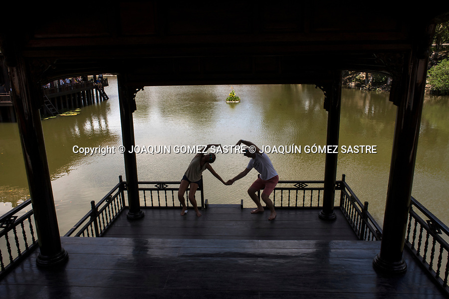A couple takes a photo at the tomb of Tu Duc in the imperial city of Hue (Vietnam)<br /> HUE-VIETNAM