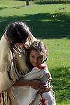 Native American Indain Lakota Sioux mother hugging her daughter