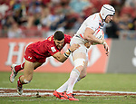 Justin Douglas of Canada tries to tackle Phil Burgess of England, who runs with the ball during the match Canada vs England, Day 2 of the HSBC Singapore Rugby Sevens as part of the World Rugby HSBC World Rugby Sevens Series 2016-17 at the National Stadium on 16 April 2017 in Singapore. Photo by Victor Fraile / Power Sport Images