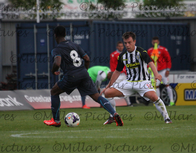 Paul McGowan closes down Vurnon Anita in the St Mirren v Newcastle United friendly match played at St Mirren Park, Paisley on 30.7.13.