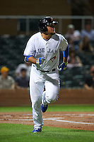 Salt River Rafters first baseman Rowdy Tellez (44) runs to first during an Arizona Fall League game against the Scottsdale Scorpions on October 13, 2015 at Salt River Fields at Talking Stick in Scottsdale, Arizona.  Salt River defeated Scottsdale 5-3.  (Mike Janes/Four Seam Images)