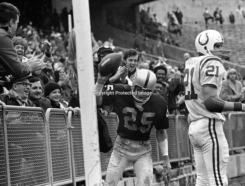 Oakland Raider Fred Biletnikott spikes the ball in the end zone to the delight of the fans. Colt #21..<br />