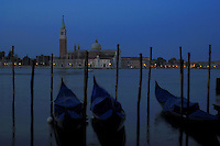 Early morning gondalas on the Grand canal in Venice with the background of San Giorgio Maggiore and marina. Venice, Italy.