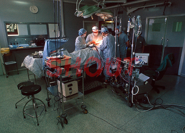 Surgeons performing heart transplant surgery in a hospital operating theatre. This image may only be used to portray the subject in a positive manner..©shoutpictures.com..john@shoutpictures.com