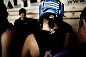 Warsaw 04.2009 Poland<br /> Young woman boxer before fight.<br /> Since the early 50' ties &quot;Gwardia&quot; has been famous for bringing up world boxing champions. The famed sports hall located by pl. Zelaznej Bramy in Warsaw witnessed trainings of Jerzy Kulej, the Skrzeczowie brothers, last Polish olympic champion Jerzy Rybicki or its most recent star Krzysztof &quot;Diablo&quot; Wlodarczyk. The club prides of numerous sport achievements, among others, 15 olympic medals (6 gold), over 60 medals from European and World Championships and over 100 from Championships of Poland.<br /> Today, only three small training halls remain from the former times of glory.<br /> One of the most famous in Polish history boxing section of Warsaw's &quot;Gwardia&quot; awaits its liquidation. This &quot;Mecca&quot; of Polish boxing is to be replaced by a huge supermarket,  decisions imposed by Warsaw authorities.<br /> ( Photo: Adam Lach / Napo Images )<br /> <br /> Mloda bokserka przed walka.<br /> Juz od wczesnych lat 50. Gwardia slynela z wychowywania swiatowych mistrzow bokserskich. W hali przy pl. Zelaznej Bramy trenowali Jerzy Kulej, bracia Skrzeczowie, ostatni polski mistrz olimpijski w boksie Jerzy Rybicki czy obecna gwiazda ringu Krzysztof &quot;Diablo&quot; Wlodarczyk. Klub moze poszczycic sie wieloma osiagnieciami sportowymi, do kt&oacute;rych przede wszystkim zaliczyc nalezy: 15 medali olimpijskich (w tym 6 zlotych), ponad 60 medali Mistrzostw Swiata i Europy i ponad 1000 medali Mistrzostw Polski. Teraz z dawnej swietnosci pozostaly zaledwie trzy male salki. Jedna z najslyniejszych w historii Polski sekcja bokserska Gwardii Warszawa ma byc zlikwidowana. Decyzja wladz Warszawy, te swego rodzaju mekke polskiego boksu ma zastapic wielki market<br /> (Fot Adam Lach / Napo Images )
