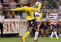 COLUMBUS, OHIO - SEPTEMBER 11, 2012:  Jermaine Jones (13) of the USA MNT goes for a high ball with Ryan Johnson (9) of  Jamaica during a CONCACAF 2014 World Cup qualifying  match at Crew Stadium, in Columbus, Ohio on September 11. USA won 1-0.