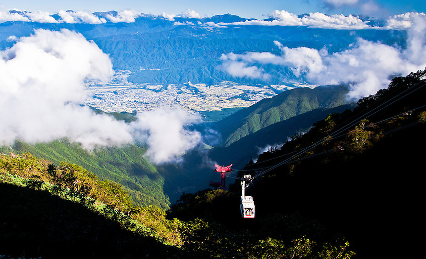 A cable car slowly edges its way up Mt.Komagatake with spectacular view of the Japan Alps.
