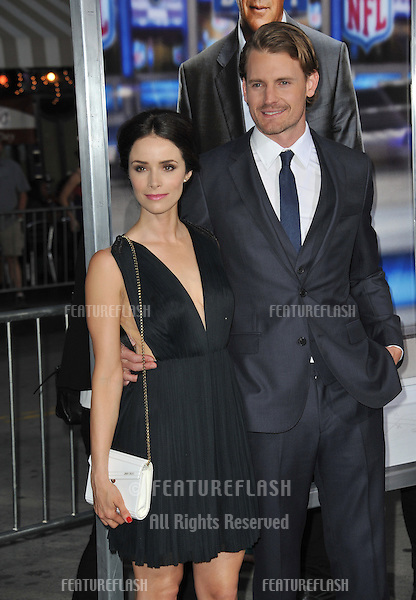 Josh Pence &amp; Abigail Spencer at the Los Angeles premiere of his movie &quot;Draft Day&quot; at the Regency Village Theatre, Westwood.<br /> April 7, 2014  Los Angeles, CA<br /> Picture: Paul Smith / Featureflash