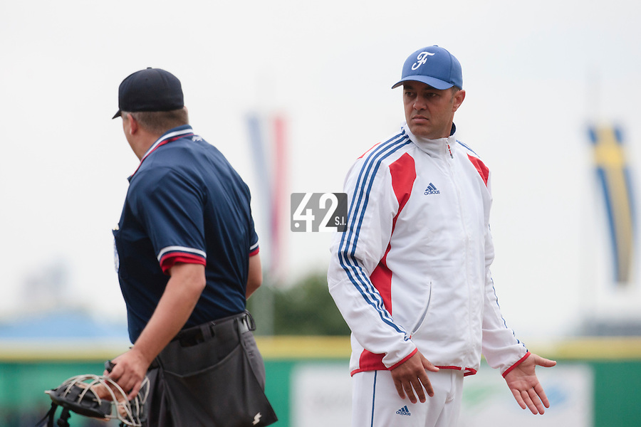 30 july 2010: Team France manager Sylvain Virey argues with home plate umpire during Sweden 3-2 win over France, in day 6 of the 2010 European Championship Seniors, at TV Cannstatt ballpark, in Stuttgart, Germany.