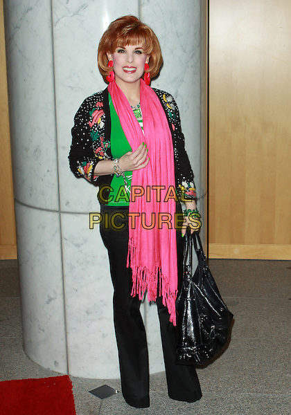 KAT KRAMER.Los Angeles Premiere of The Killing Jar  held at the Clarity Theatre, Beverly Hills, California, USA..March 17th, 2010.full length pink scarf black bag trousers hand beaded green patterned jacket .CAP/ADM/TC.©T. Conrad/AdMedia/Capital Pictures.