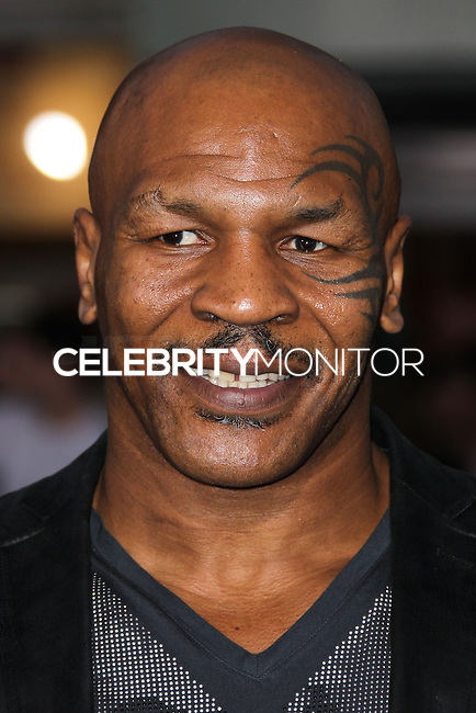 """WESTWOOD, LOS ANGELES, CA, USA - APRIL 07: Mike Tyson at the Los Angeles Premiere Of Summit Entertainment's """"Draft Day"""" held at the Regency Bruin Theatre on April 7, 2014 in Westwood, Los Angeles, California, United States. (Photo by Xavier Collin/Celebrity Monitor)"""