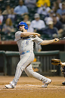Cody Decker #6 of the UCLA Bruins follows through on his swing versus the Rice Owls in the 2009 Houston College Classic at Minute Maid Park February 27, 2009 in Houston, TX.  The Owls defeated the Bruins 5-4 in 10 innings. (Photo by Brian Westerholt / Four Seam Images)