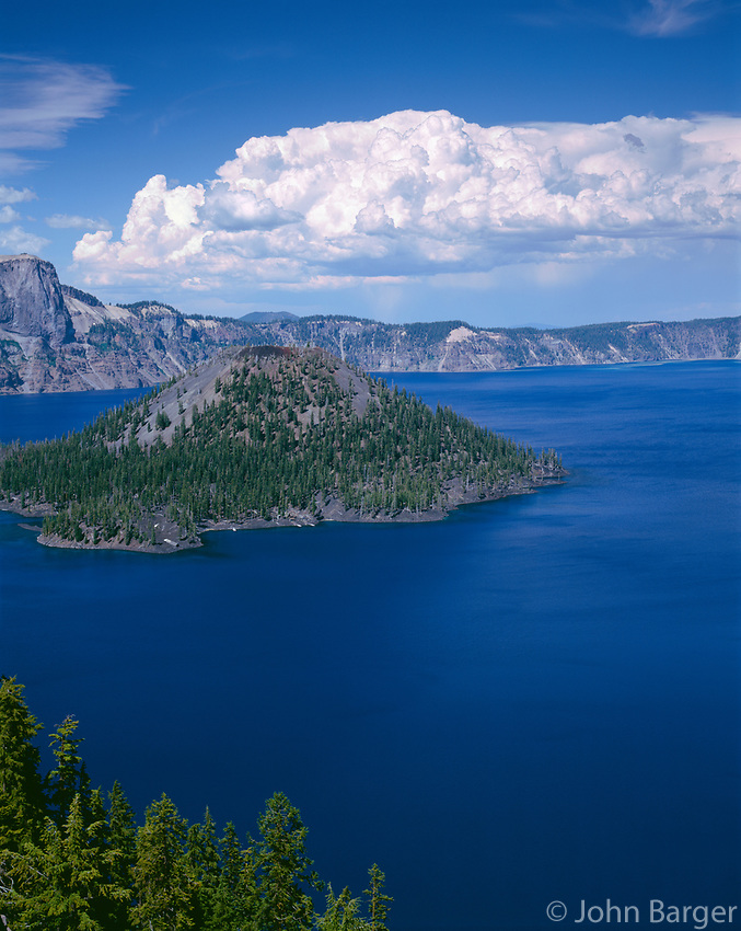 ORCL_053 - USA, Oregon, Crater Lake National Park, Thunder clouds float over Wizard Island and Crater Lake.