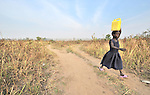 A girl carries water home from a well provided by the United Methodist Committee on Relief, in Yei, Southern Sudan. NOTE: In July 2011, Southern Sudan became the independent country of South Sudan