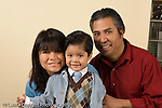 portrait of 3 year old boy with his parents mother and father horizontal