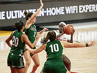 COLLEGE PARK, MD - DECEMBER 8: Ashley Owusu #15 of Maryland holds the ball back from the Loyola defense during a game between Loyola University and University of Maryland at Xfinity Center on December 8, 2019 in College Park, Maryland.