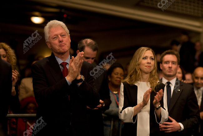 """Senator Hillary Clinton (D-NY), potential 2008 Democratic presidential candidate, accompanied by her husband, former U.S. President Bill Clinton, and daughter, Chelsea Clinton, gives a speech to supporters as """"Super Tuesday"""" election results roll in. New York City, February 5, 2008."""