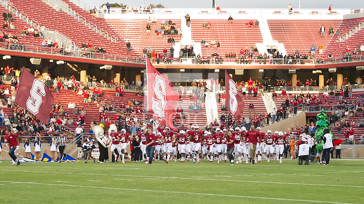 STANFORD, CA - April 14, 2012: Stanford team running out on the field prior to the Stanford Cardinal vs San Jose St. game at Stanford Stadium at Sanford, CA. Final score Stanford 20, San Jose St. 17.