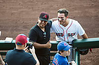 Mesa Solar Sox second baseman Esteban Quiroz (2), of the Boston Red Sox organization, takes a photo with a fan after an Arizona Fall League game against the Glendale Desert Dogs at Sloan Park on October 27, 2018 in Mesa, Arizona. Glendale defeated Mesa 7-6. (Zachary Lucy/Four Seam Images)