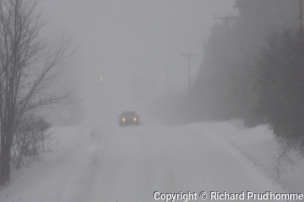 Heavy snow falling and winds makes for poor driving visibility