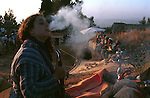 A settler smokes a hookah at the site of a religious music festival in the Israeli settlement of Bat A'in, West Bank.