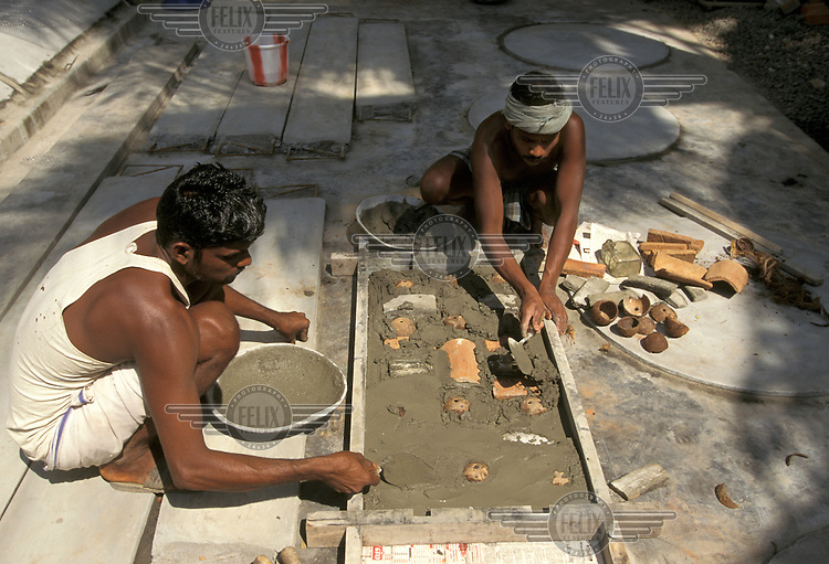 ©Caroline Penn/Panos Pictures..Tamil Nadu  INDIA..Rural Technology Centre.  Building a cement panel using waste materials.