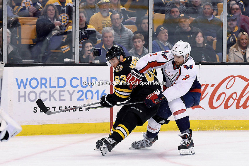 Saturday, March 5, 2016: Washington Capitals defenseman Matt Niskanen (2) and Boston Bruins left wing Brad Marchand (63) battle for the puck during the National Hockey League game between the Washington Capitals and the Boston Bruins, held at TD Garden, in Boston, Massachusetts. Washington defeats Boston 2-1 in overtime. Eric Canha/CSM