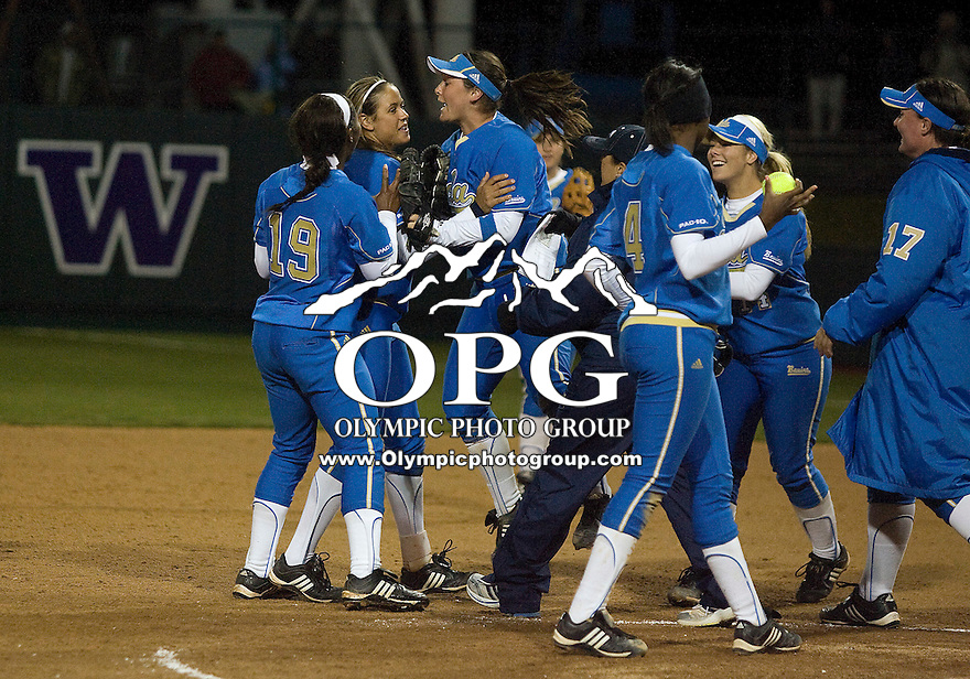 1 April 2010:  UCLA players celebrate on the field after the shut out the #1 ranked Washington Huskies. UCLA defeated Washington 1-0 at Husky Softball Stadium in Seattle, WA.