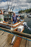 USA, Alaska, Ketchikan, the main guide and fisherman cleans the boat after a trip to Behm Canal near Clarence Straight, Knudsen Cove along the Tongass Narrows